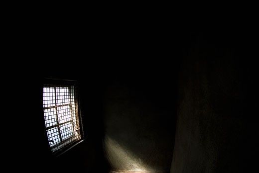 Sunlight entering a dark room through a window : Stock Photo