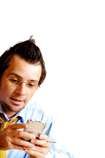 Close-up of a businessman operating a personal data assistant : Stock Photo