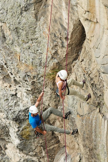Stock Photo: 1663R-21124 High angle view of a male and a female rock climber scaling a rock face