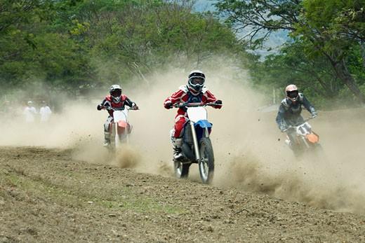 Motocross riders riding motorcycles : Stock Photo