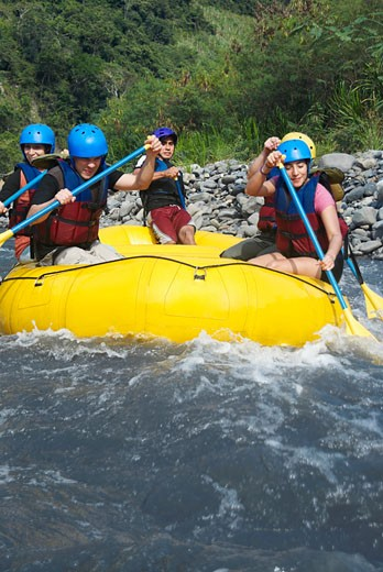 Five people rafting in a river : Stock Photo