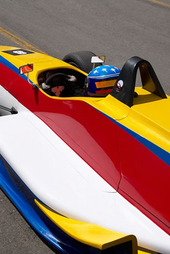 Stock Photo: 1663R-21579 High angle view of a racecar driver in a racecar