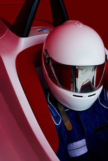 Close-up of a racecar driver in a racecar : Stock Photo