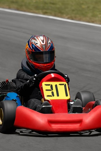 Stock Photo: 1663R-21595 Person go-carting on a motor racing track