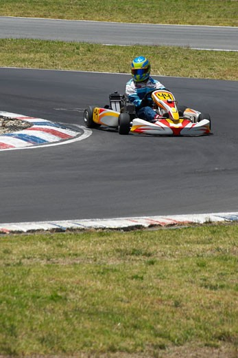 Stock Photo: 1663R-21596 Person go-carting on a motor racing track