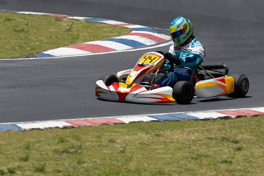 Stock Photo: 1663R-21605 Person go-carting on a motor racing track