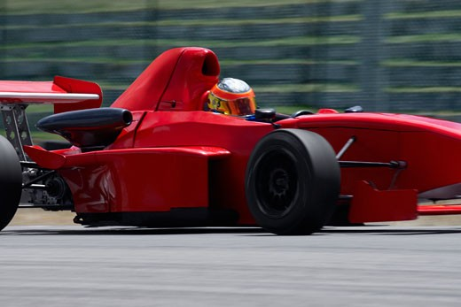 Stock Photo: 1663R-21765 Person driving a formula one racing car on a motor racing track