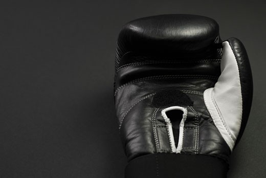 Close-up of a black boxing glove : Stock Photo