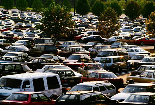 Shopping center parking lot with allot of cars in Georgia : Stock Photo