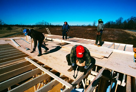 Stock Photo: 1663R-23061 Carpenters working on new home in Prince Georges County , Maryland