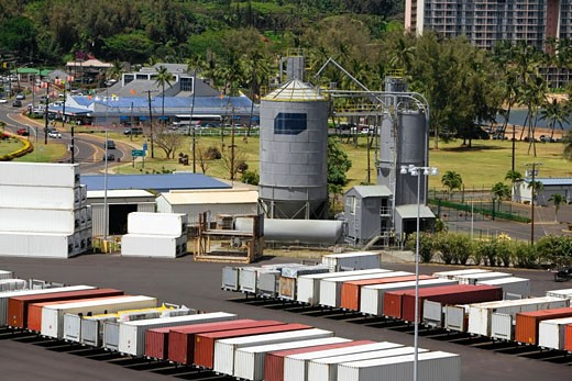 Stock Photo: 1663R-23596 High angle view of cargo containers and a storage tank at a commercial dock