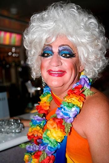 Stock Photo: 1663R-23698 Portrait of a mature woman in bizarre fashion