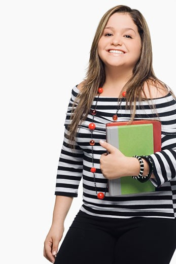 Portrait of a young woman holding a book and a diary : Stock Photo