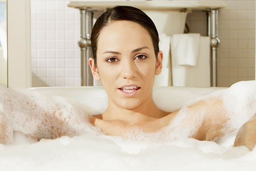 Portrait of a young woman in a bathtub : Stock Photo