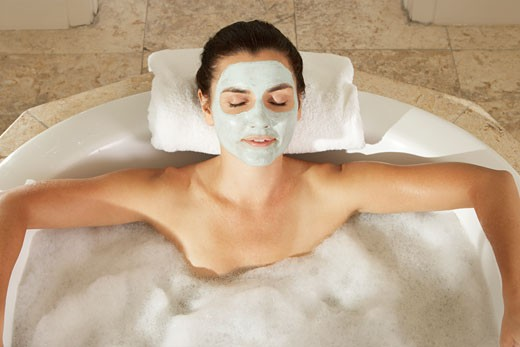 Stock Photo: 1663R-25400 High angle view of a young woman in a bubble bath with her eyes closed