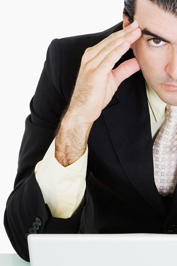 Portrait of a businessman with his head in his hands thinking : Stock Photo