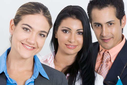 Stock Photo: 1663R-26269 Portrait of a businessman and two businesswomen smiling