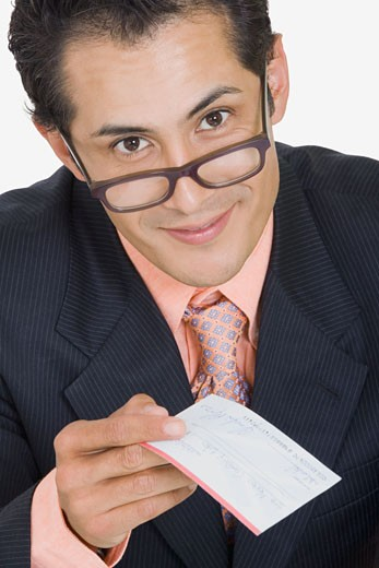 Stock Photo: 1663R-26363 Portrait of a businessman holding a check