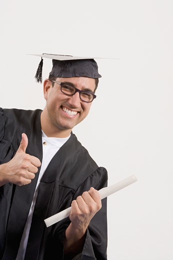 Stock Photo: 1663R-26710 Portrait of a mid adult man showing a thumbs up sign and holding a diploma