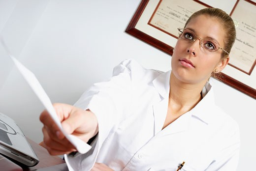 Close-up of a female doctor giving a report : Stock Photo