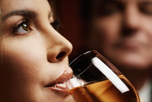 Close-up of a mid adult woman drinking wine : Stock Photo