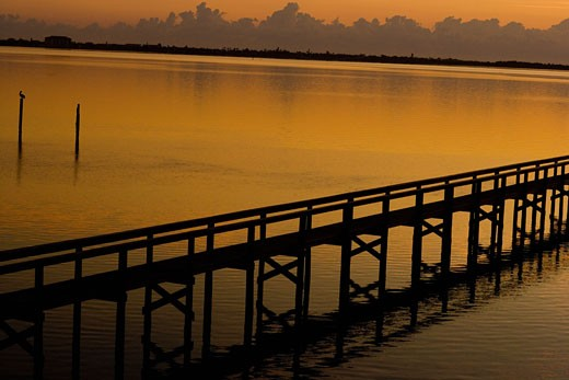 Silhouette of a pier in the sea, St. Augustine Beach, Florida, USA : Stock Photo
