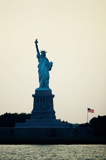 Silhouette of a statue at dusk, Statue Of Liberty, New York City, New York State, USA : Stock Photo