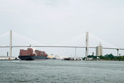 Container ship in a river with a suspension bridge in the background, Talmadge Bridge, Savannah River, Savannah, Georgia, USA : Stock Photo