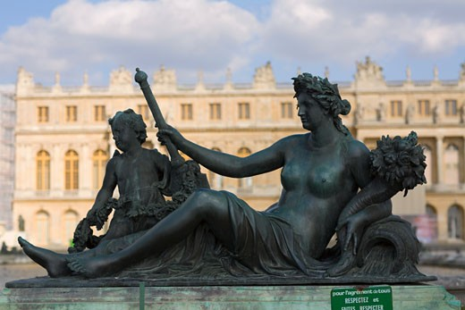 Statue in front of a palace, Palace of Versailles, Versailles, France : Stock Photo
