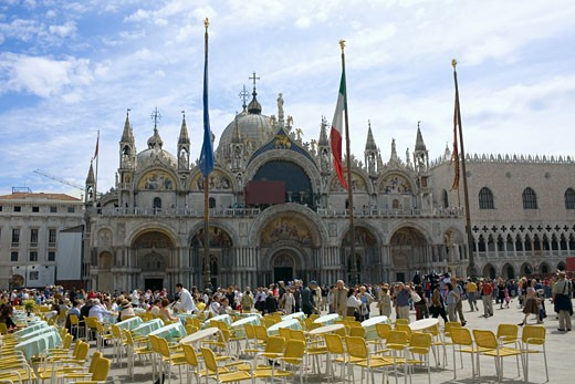 Stock Photo: 1663R-28655 Tourists walking in front of a church, St. Mark's Cathedral, St. Mark's Square, Venice, Italy