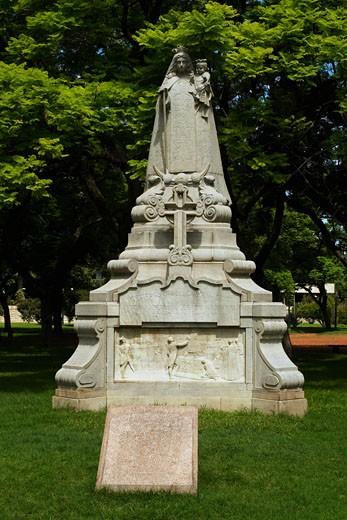 Monument in a garden, Nuestra Senora Del Carmen De Cuyo, Patrona Del Ejercito, Plaza Aguero, Buenos Aires, Argentina : Stock Photo