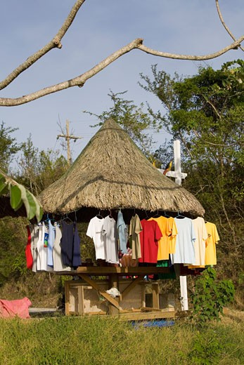 T-shirts hanging on a stall, Jonesville, Roatan, Bay Islands, Honduras : Stock Photo