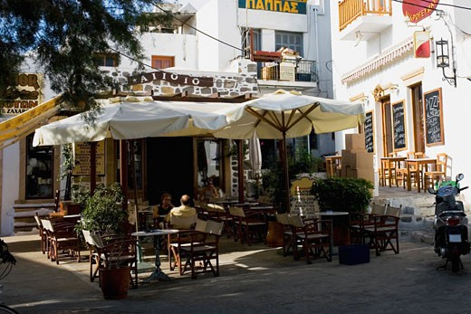 Stock Photo: 1663R-30471 Sidewalk cafe in a city, Patmos, Dodecanese Islands, Greece