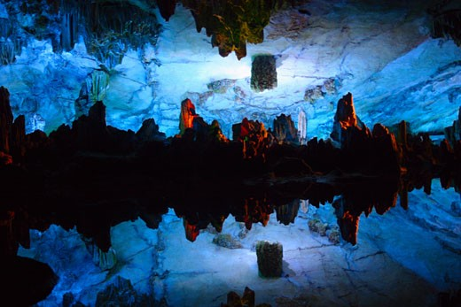 Reflection of rocks in water, Seven Star Cave, Guilin, China : Stock Photo
