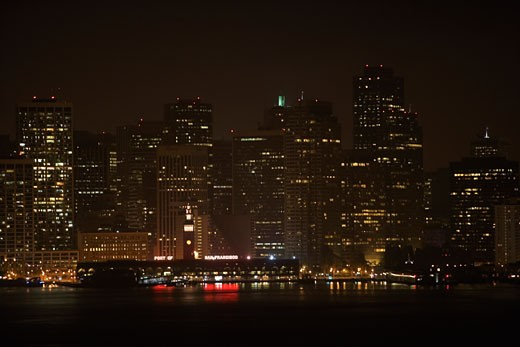 Stock Photo: 1663R-32141 Illuminated buildings at waterfront, California, USA