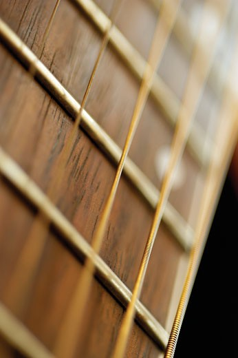 Extreme close-up of guitar frets and strings : Stock Photo