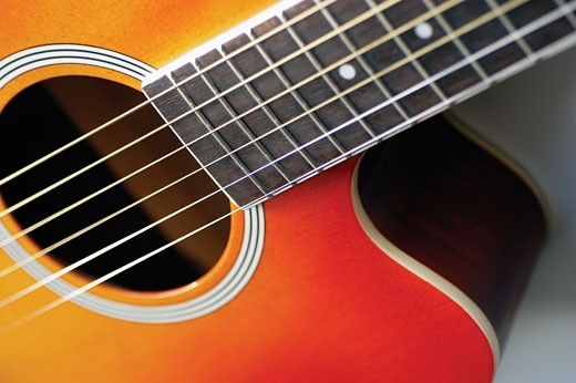 Stock Photo: 1663R-32455 Close-up of guitar, its strings and frets