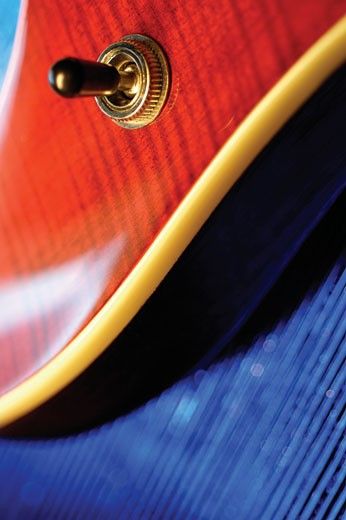 Extreme close up of knob on electric guitar : Stock Photo