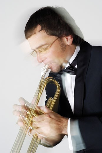 Close-up of a musician playing the trumpet : Stock Photo