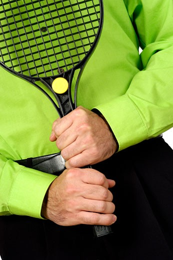 Stock Photo: 1663R-33596 Mid section view of a man holding a tennis racket