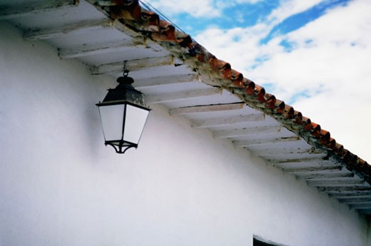 Low angle view of a lantern hanging from eaves : Stock Photo