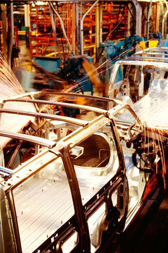 Robots welding a row of cars in an assembly line, Baltimore, Maryland, USA : Stock Photo