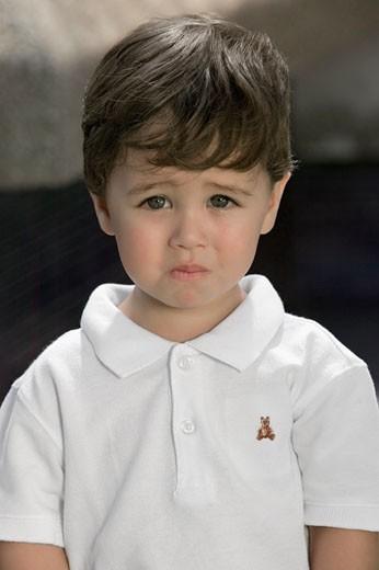 Portrait of a boy looking sad : Stock Photo