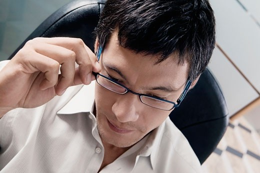 Close-up of a businessman thinking : Stock Photo