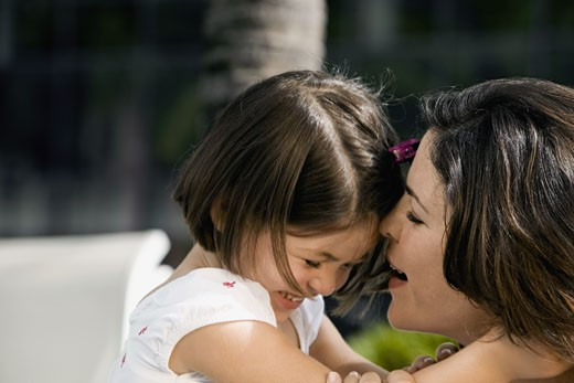 Stock Photo: 1663R-35317 Close-up of a daughter hugging her mother