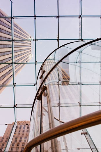 Low angle view of a skyscraper through a glass ceiling : Stock Photo