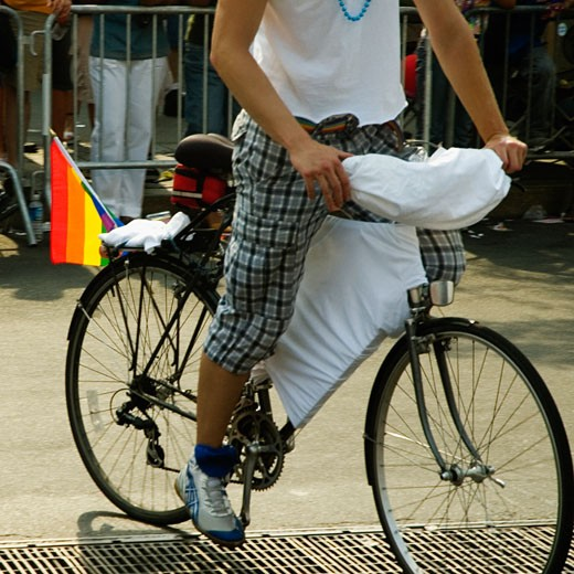 Low section view of a man riding a bicycle : Stock Photo