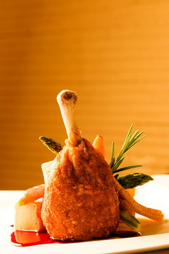 Chicken drumstick served with salad : Stock Photo