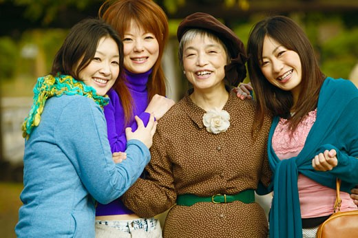Portrait of a mature woman and her three daughters  : Stock Photo