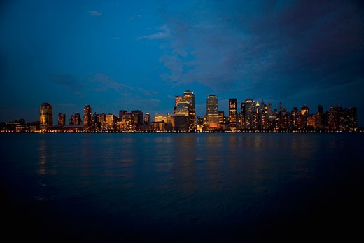 Stock Photo: 1663R-37521 Skyscrapers at the waterfront lit up at night, New York City, New York State, USA